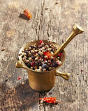 Various spices in mortar and pestle Royalty Free Stock Photos