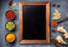 Various Spices Near Blackboard Royalty Free Stock Photo