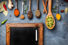 Various Spices Near Blackboard Stock Images