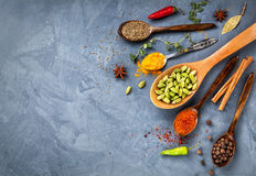 Various Spices Near Blackboard At Blue Stone Background Stock Images