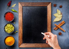 Various Spices near blackboard at blue stone background Stock Image