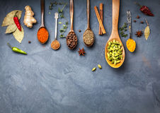 Various Spices near blackboard at blue stone background Royalty Free Stock Photo
