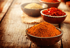 Various spices over wooden background Royalty Free Stock Photography