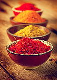 Various spices over wooden background Royalty Free Stock Photo