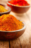 Various spices over wooden background Stock Images