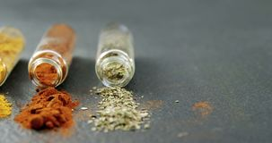 Various spices spilled out of jar 4k. Close-up of various spices spilled out of jar 4k stock footage