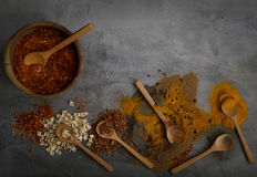 Various spices spoons on stone table. Top view with copy space Stock Image