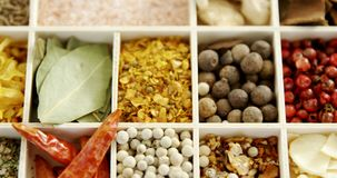 Various spices in a tray 4k. Overhead of various spices in a tray 4k stock footage