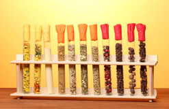 Various spices in tubes on wooden table Royalty Free Stock Photography