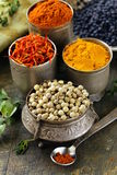 Various spices (turmeric, paprika, saffron, coriander) Stock Photo