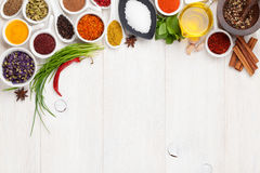 Various spices on white wooden background stock photography