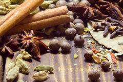 Various spices on a wooden background Royalty Free Stock Image