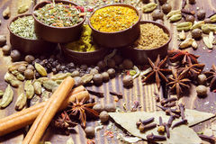 Various spices on a wooden background Stock Photos