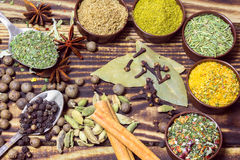 Various spices on a wooden background Royalty Free Stock Images