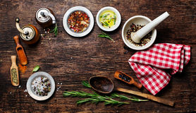 Various spices on wooden background Royalty Free Stock Images