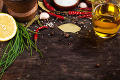 Various spices on wooden background Royalty Free Stock Image