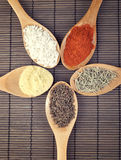Various spices in wooden spoons Stock Photo