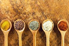 Various spices in wooden spoons Royalty Free Stock Image