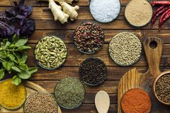 Various spices on wooden surface. Top view of various spices on a wooden brown surface Royalty Free Stock Photography
