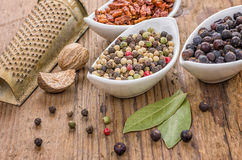 Various spices on a wooden table Royalty Free Stock Photos