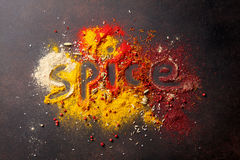 Various spices. Word Spice drawing on various spices on stone table. Top view Royalty Free Stock Photo