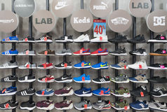 Various sports footwear in store Royalty Free Stock Photography