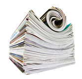 Various stacked and rolled magazines over white Stock Photo