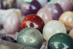 Various stone or rock polished balls, magic esoteric mineral objects or geology textured round samples. Selective focus Stock Photography