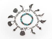 Various stylish silver bracelets with natural stone decoration on white background Stock Image