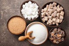 Various sugar in bowls. Top view Royalty Free Stock Image