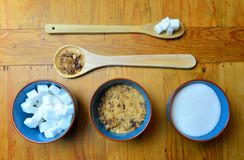 Sugar on a wooden table Royalty Free Stock Image