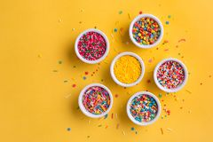 Various sugar sprinkles. Food background with copy space. Overhead view Stock Photo