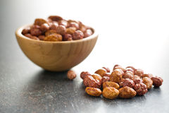 Various sugared nuts. In bowl stock photos