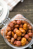Various sugared nuts in jar Royalty Free Stock Image