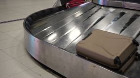 Various suitcases on conveyor belt at the airport.  stock video