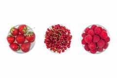 Fresh cherry, currant, raspberries on plate on Isolated white background. fresh ripe cherries. sweet cherries. Berries. Various summer Fresh berries in a bowl Stock Photos