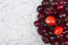 Various summer Fresh Cherry in a bowl on rustic wooden table. Antioxidants, detox diet, organic fruits. Top view. Various summer Fresh Cherry in a bowl on rustic Royalty Free Stock Image