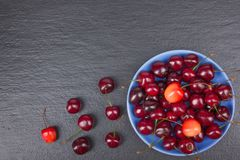 Various summer Fresh Cherry in a bowl on rustic wooden table. Antioxidants, detox diet, organic fruits. Top view. Various summer Fresh Cherry in a bowl on rustic Stock Photo