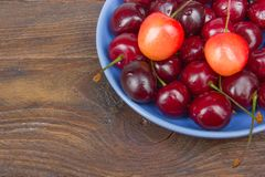 Various summer Fresh Cherry in a bowl on rustic wooden table. Antioxidants, detox diet, organic fruits. Berries Stock Image