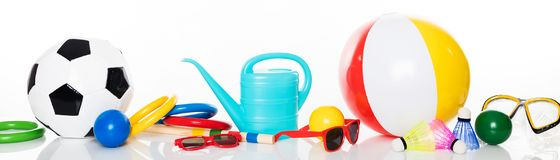 Various summer toys for leisure activities. Panorama with various summer toys for leisure activities, isolated in front of white background stock photos