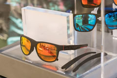 Various of sun glasses in the shop display shelves. Selective fo Stock Images