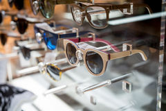 Various of sun glasses in the shop display shelves. Stock Images