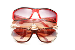 Various sunglasses isolated. On the white background Stock Photography