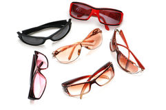 Various sunglasses isolated. On the white background Stock Photos