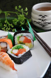 Various sushi with japanese tea Stock Photo