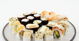 Various sushi on plate. Against white backghround stock footage
