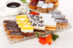 Various sweet cakes on oblong plate Stock Photos