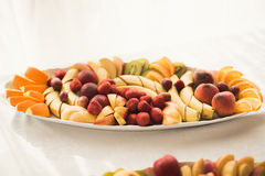 Various sweet sliced fruit on a buffet table Stock Photos