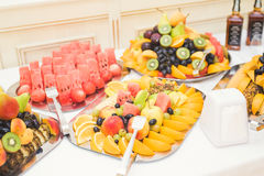 Various sweet sliced fruit on a buffet table Royalty Free Stock Photos
