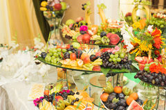 Various sweet sliced fruit on a buffet table Stock Image